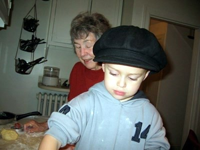 Trudy teaching Jack to make rolls