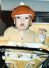 6 month old Michael with his Buster Brown hat on. October 1, 1974.